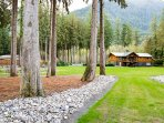 Property View From The North Side!  Just Behind That Stunning Lodge Is a Beautiful Chilliwack River