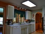 Spacious kitchen.  All appliances. Toaster oven dishwasher, coffee pot, stove and refrig. Micorwave/