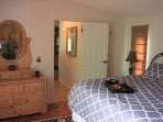 The master bedroom w/ king size bed and private bathroom.