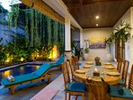 Spacious dining and lounge zone opening onto the garden and swimming pool