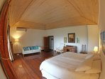 Wide angle photo of the gorgeous master bedroom.