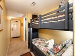 Customized to unit 406, bunk beds have their own TV'S & STORAGE!