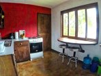 Kitchen with stove with stove, fridge with freezer, breakfast table to enjoy the views