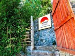 The entrance of Sunset Lodge .. some steps to take you closer to the sky