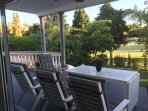 17 Seating & Table on terrace with view of garden & golf course