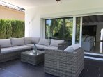 18 View of covered terrace with large couch seating area