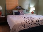 New, firm, king size bed. Organic cotton bed sheets and pillows. No chemicals! Just clean linens.