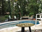 Pool features beach entry, wet deck and deep plunge, plus a variety of sun or shade spaces to relax.