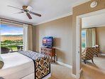 Let the Maui mountains move you as you relax in the Master Bedroom.