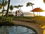 Sit right at the pool and enjoy the gorgeous sunsets nightly.