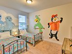 Kids will love sleeping in this cartoon-themed bedroom with 2 twin beds.