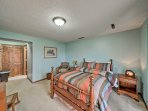 A comfortable full bed is featured in the spacious downstairs bedroom.