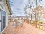 Located along the Iowa River, this home features a viewing deck, outdoor fire pit, and access to a private dock.