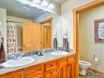 Wash up in the shower/tub combo and his-and-hers vanity featured in the en-suite master bathroom.