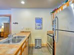 The kitchen is fully equipped with stainless steel appliances and everything you'll need to cook at home.