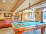 Enjoy afternoons in the community room, which features a pool table, foosball table, a  fireplace, and a large...