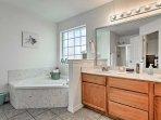 Pour a bubble bath in the master en-suite bathroom.