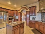 Fully equipped with stainless steel appliances and granite countertops, this gourmet kitchen is sure to please any cook!
