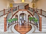 A large foyer lined with a dramatic double staircase and cathedral ceiling welcomes you inside and sets the tone for...