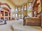 The master bedroom is distinguished by a two-story wall of windows and custom woodwork.