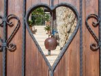 Wooden gates lead to the entrance steps to the villa