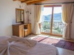 The master bedroom offers stunning views out over the bay