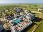 Aerial view of The Beach Club with huge infinity edge pool, hot tub, children's pool, fitness center