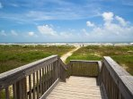 Boardwalk to the pristine private beach is steps away from our home