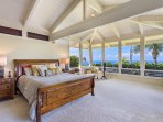 The sprawling master bedroom has quite a view.