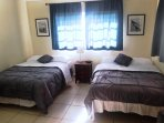Large Bedroom with 2 Full Size Beds Always Provided with New Bed Sheets