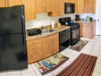 Full kitchen with all kitchenette with coffee, tea, refrigerator, stow, owen