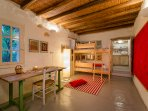 Kids' bedroom or activity room in lower cottage