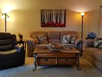 Living Room has Rocker Recliner, Large Flat Screen Cable TV/DVD Player