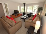Relax and unwind in the spacious living area, complete with a TV.