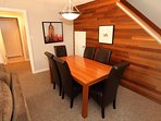 Have dinner at the beautiful wooden dining table.