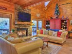Gather around the gas fireplace and watch a movie on the flat-screen cable TV.