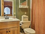 Get freshened up in the shared full bathroom.