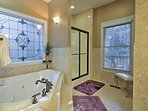 Pour yourself a bubble bath in the master bathroom!