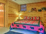 The third bedroom boasts a king bed and rustic furnishings.