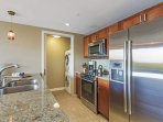Step through the kitchen to access the laundry room.