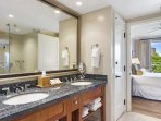 The bathroom has a double vanity, a soaking tub, and a separate walk-in shower.