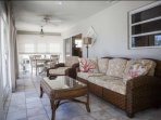 Additional living space and seating arrangements are provided in the family room.