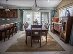 Breakfast bar seating for up to 4 guests, and large formal dining table with seating for up to 8 guests.