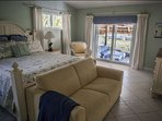 Coastal inspired master bedroom suite complete with a king size bed and private access to the patio.