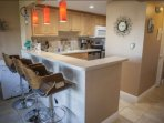 Recently renovated kitchen provides breakfast bar seating for up to 3 guests.