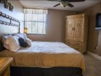 Master suite complete with a flat screen TV and plenty of storage options for your belongings.