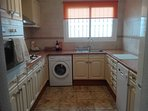 Kitchen, fitted with fridge freezer dishwasher gas hob electric oven and washing machine