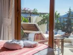The twin bedroom leads out onto a large balcony with sun beds