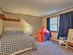 Kids can rest easy in this third bedroom that provides a cozy full-sized bed.