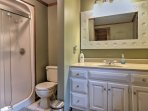 Feel refreshed with a rinse in the en-suite bathroom walk-in shower.
